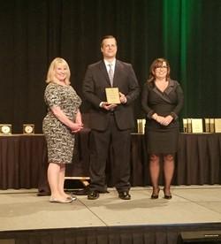 Matt Gain, Teacher of the Year accepts award