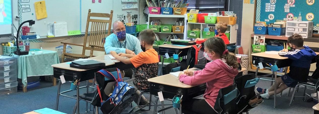 Principal Zeman visits with students