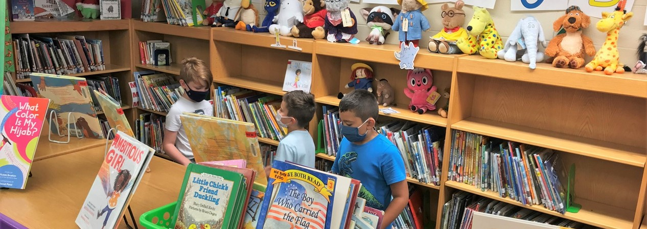 Students Choosing Books at Library